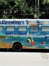 A bus fitted as a mobile bathroom painted with scenes of Pattaya beach.
